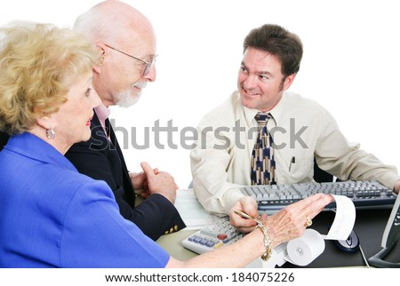 Senior couple going over their taxes with an accountant.  White background.   - stock photo
