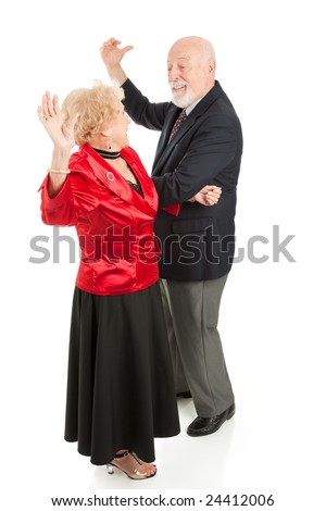 Senior couple having a great time dancing together.  Full body isolated on white. - stock photo
