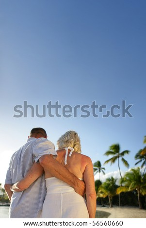 Senior couple having a walk at the seaside - stock photo