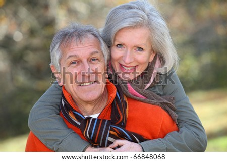 Senior couple having fun in countryside - stock photo