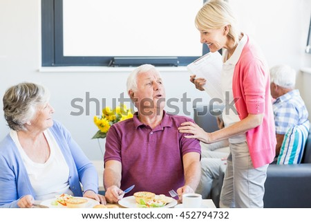 Senior couple having lunch together in a retirement home - stock photo