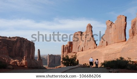 Senior Couple Hiking at Park Avenue, Arches National Park, Utah USA - stock photo