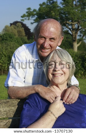 Senior couple in a park on a summers evening.