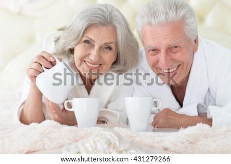 Senior couple in bed with tea