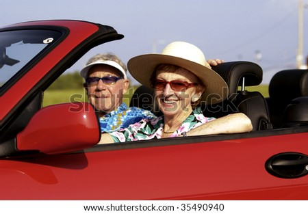 senior couple in convertible - stock photo