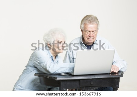 Senior couple is concerned with bills - stock photo