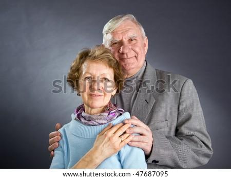 Senior Couple Isolated on a Grey Background - stock photo