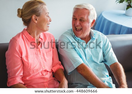 Senior couple laughing together in a retirement home - stock photo