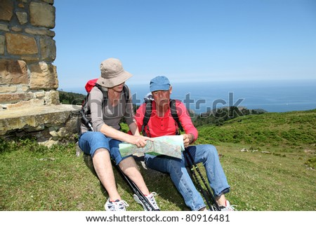 Senior couple looking at map on hiking day