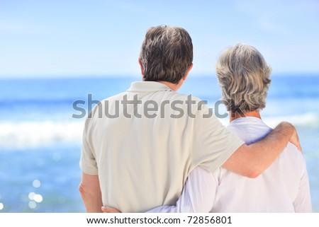Senior couple looking at the sea - stock photo