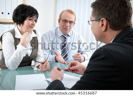 Senior couple meeting with agent - stock photo