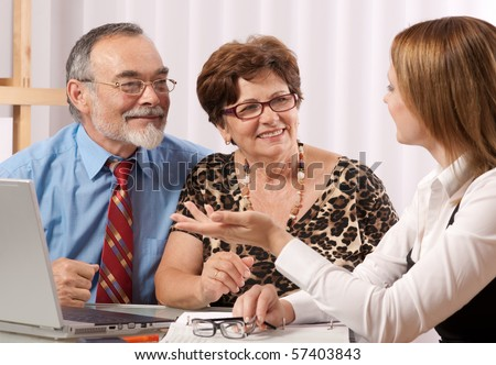 Senior couple meeting with agent or advisor - stock photo