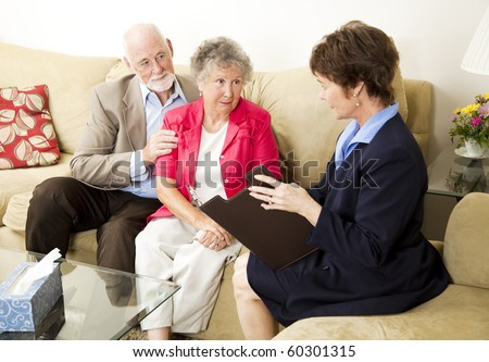Senior couple meets with a marriage counselor. - stock photo