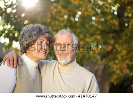 Senior couple outside on a sunny fall day