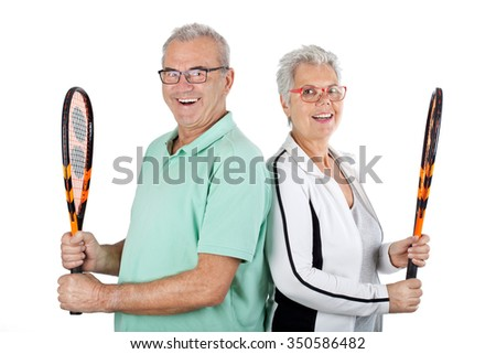 Senior couple playing Badminton, Healthy fitness elderly couple. Sport and exercise concept - stock photo