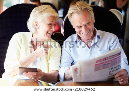 Senior Couple Relaxing On Train Journey - stock photo