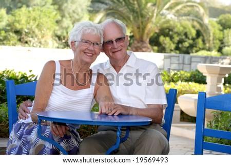 senior couple relaxing outdoors - stock photo