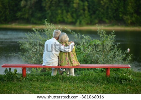 Senior couple resting at park - stock photo