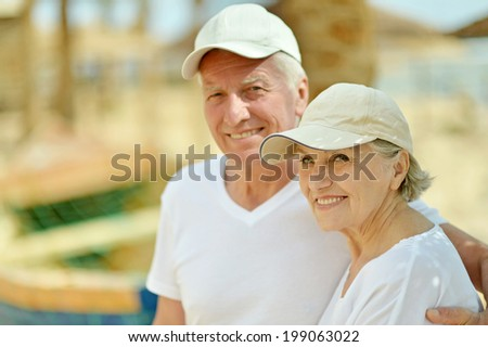 Senior couple resting at the resort during vacation - stock photo