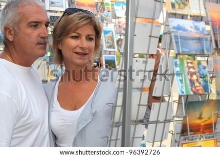 senior couple shopping during vacation - stock photo