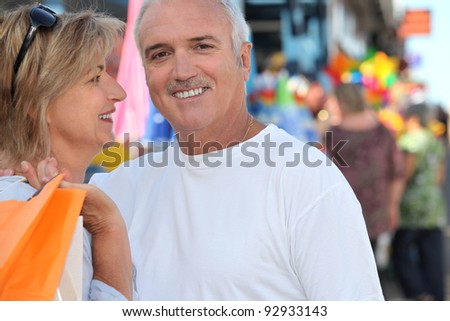 senior couple shopping together - stock photo