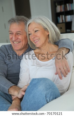 Senior couple sitting in sofa at home