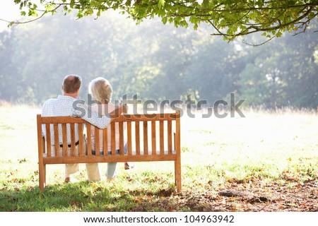 Senior couple sitting outdoors - stock photo