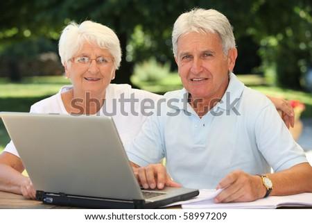 Senior couple surfing on internet - stock photo