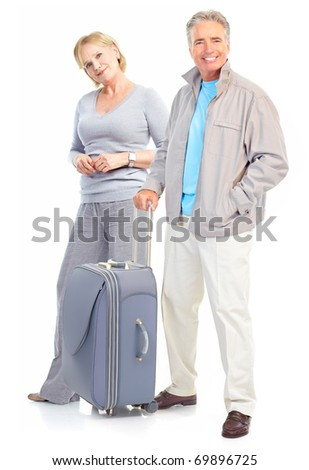 Senior couple travelers with bags. Isolated over white background - stock photo