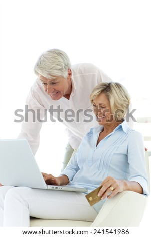 senior couple using laptop for e-shopping - stock photo