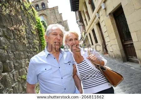 Senior couple visiting northern spanish town - stock photo