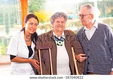 senior couple with a nurse - stock photo