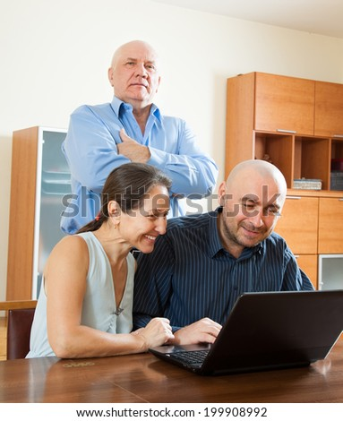 Senior couple with adult man in internet