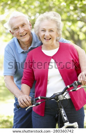Senior couple with bike - stock photo