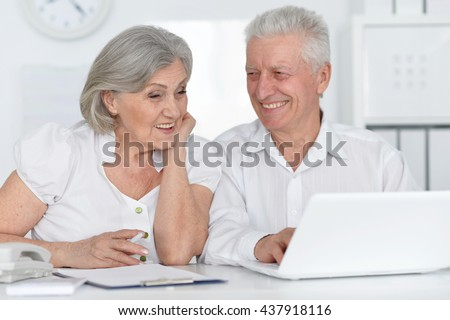 Senior couple  with laptop