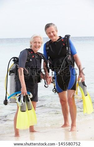 Senior Couple With Scuba Diving Equipment Enjoying Holiday - stock photo
