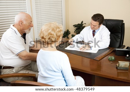 Senior couple with the doctor, going over medical history. - stock photo