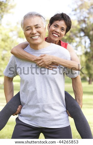 Senior Couple Working Out In Park - stock photo