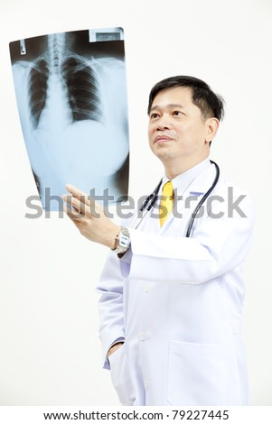 Senior doctor checking xray results - stock photo