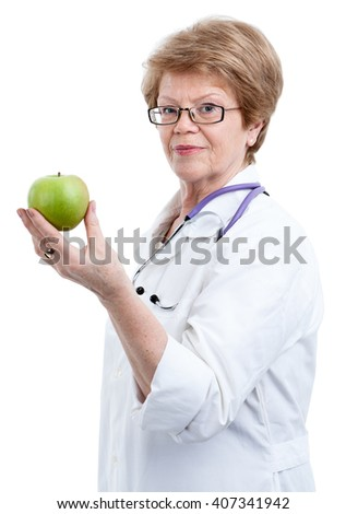Senior doctor nutritionist holding green apple in one hand, isolated on white background - stock photo