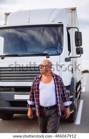 Senior driver in front of his truck.