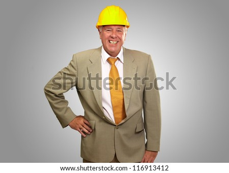 Senior Engineer Standing And Smiling On gray Background - stock photo