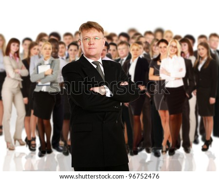 senior executive standing in front of team