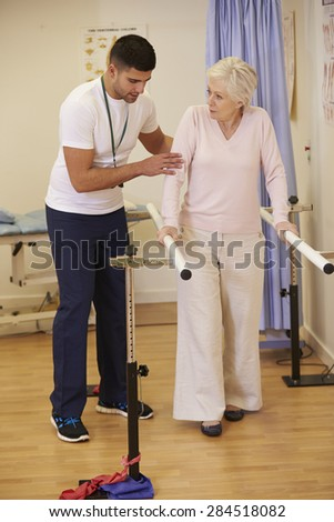 Senior Female Patient Having Physiotherapy In Hospital