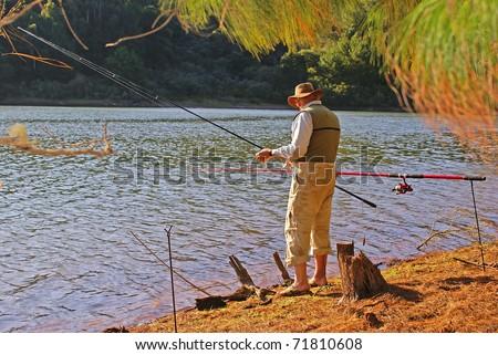 Senior fisherman - stock photo
