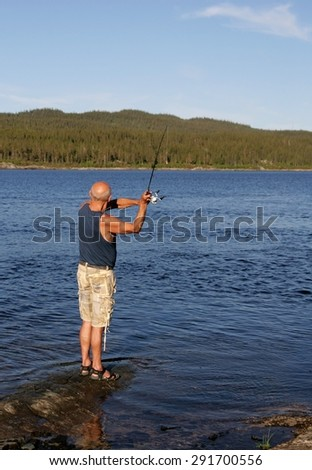 Senior fishing by a lake