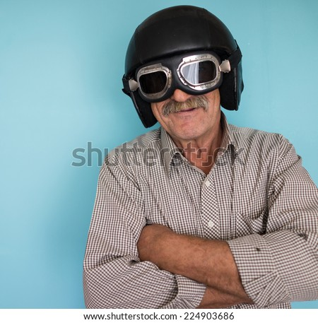 Senior funny man as a pilot with hat and glasses - stock photo