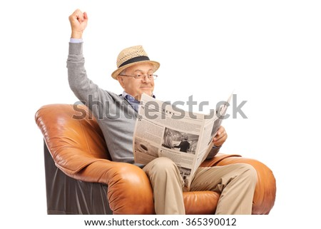Senior gentleman reading the news and celebrating with his fist in the air isolated on white background - stock photo