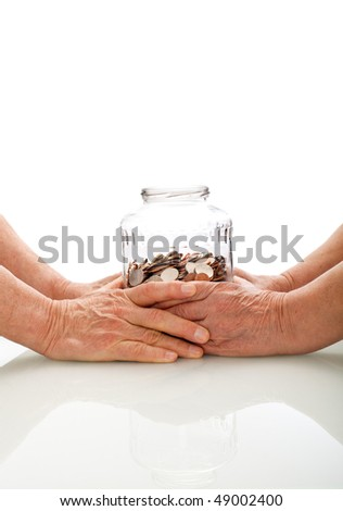 Senior hands holding a jar with coins - retirement fund concept, isolated - stock photo
