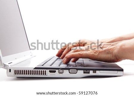 Senior hands typing on the computer keyboard - stock photo